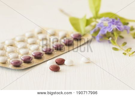 birth control pills of baby for woman on white