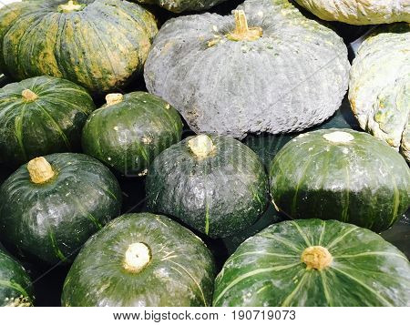 Vegetable Pile of Fresh Pumpkin in Supermarket or Grocery Shop. One of Vitamin Nutrients to Improve Nutrient Intake and Health Benefits.