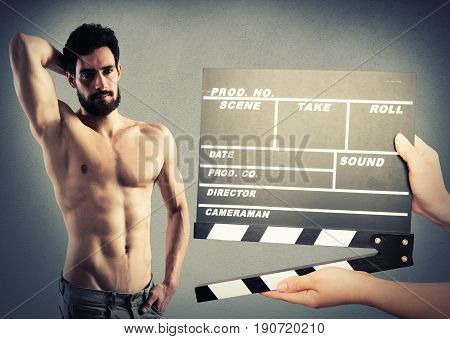 Film in action with a nude muscle man