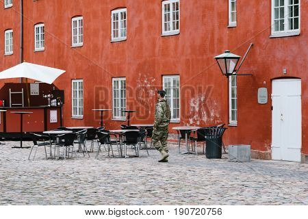 Copenhagen Denmark - August 10 2016. A soldier in the Kastellet a cloudy day of summer. It is one of the best preserved star fortresses in Northern Europe. It is constructed in the form of a pentagram with bastions at its corners.