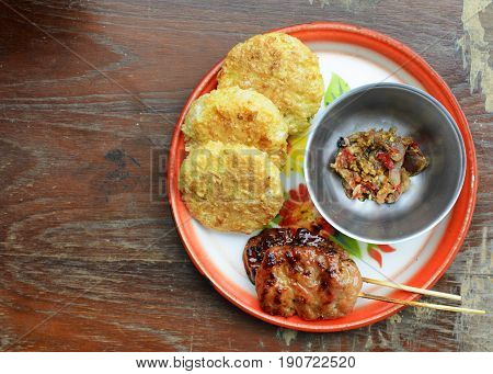 Khao Jee Sticky rice with egg and grilled pork and spicy suace for Thai e-saan local foods backgrounds above