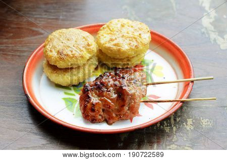 Khao Jee Sticky rice with egg and grilled pork for Thai e-saan local foods backgrounds