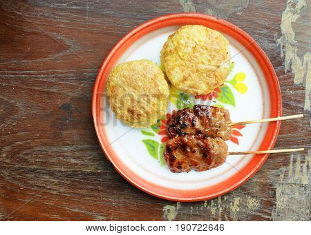 Khao Jee Sticky rice with egg and grilled pork for Thai e-saan local foods backgrounds above