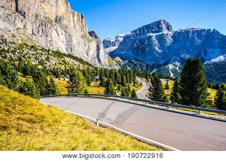Autumn in the Tirol, Dolomites. Picturesque highway through the Sella Pass. Impressive ridge of dolomite rocks. The concept of ecological and extreme tourism