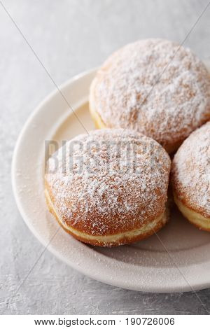 Delicious lush donuts berliners with powdered sugar