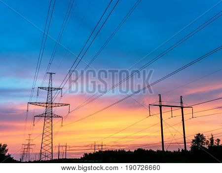high voltage post. High-voltage tower sky backgroundbesides the highway