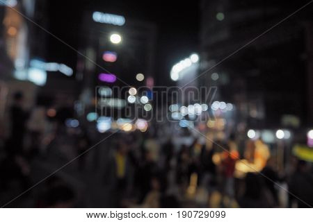 Blur image of myeongdong open street market at south korea.