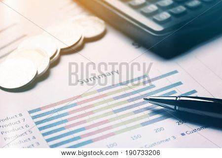 Finance savings concept business equipment on paperwork.