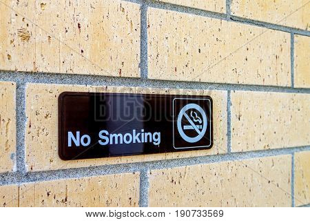 No smoking sign on a brick wall