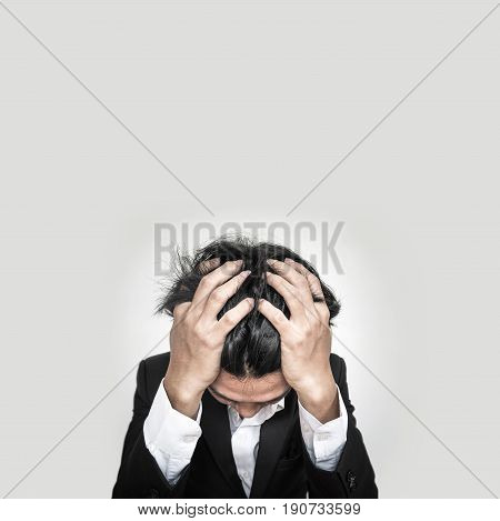 Stressed Young Businessman , on white background