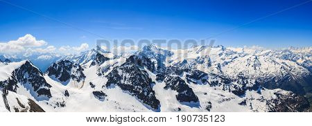 Panorama of the snow mountain range mountain range from the Titlis is a mountain of the Uri Alps Engelberg Switzerland.