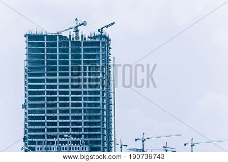 Hoisting cranes under construction crane working building construction urban metro expand. high rise building
