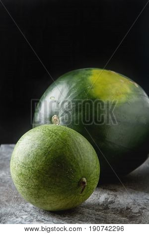 Watermelon Whole. Grey Stone Background. Autumn Photos.