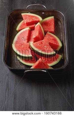 Watermelon Cut Into Slices. Dark Wood Background. Autumn Photos.