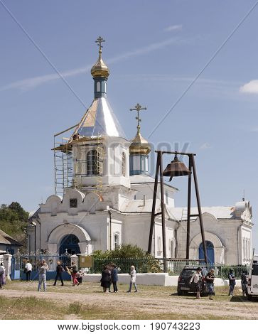 Razdorskaya Rostov Region; Russia - June 04; 2017:Church of the Nativity of the Blessed Virgin in the village of Konygin (1879). Workers repair the roof.Parishioners came to church service