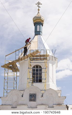 RazdorskayaRostov Region Russia- June 04; 2017:Church of the Nativity of the Blessed Virgin in the village of Konygin (1879). Workers repair the roof