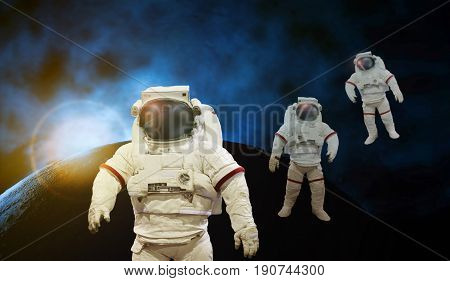 astronaut working on space with sun light with earth and cosmos background