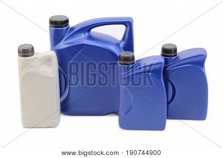 Automotive oils in plastic cans on white background isolation