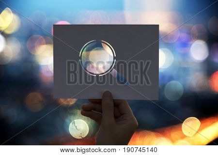 Searching discovery perforated paper magnifying glass