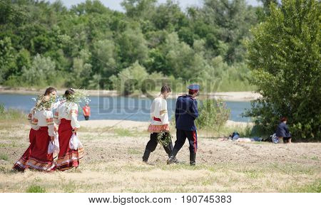 RazdorskayaRostov Region Russia- June 04; 2017:Cossack youth goes to throw wreaths in the river Don to the Trinity