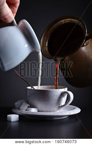 Cup Of Coffee With Milk On Dark Background
