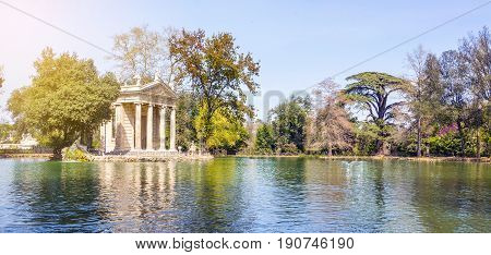 Temple of Aesculapius and the lake in Villa Borghese Gardens Rome Italy