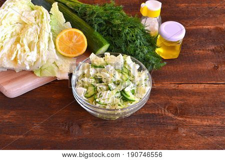 Salad with Chinese cabbage and cucumbers. Vegetables, lemon, vegetable oil, healthy food