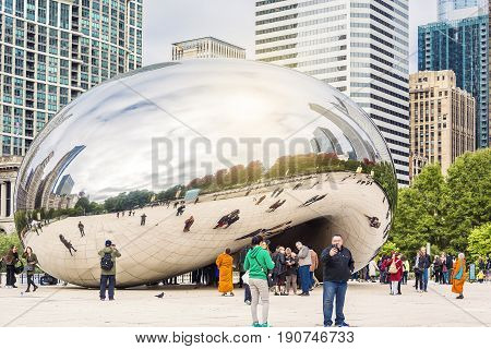 Chicago IL USA october 27 2016: Cloud Gate one of the most unique and interesting sculptures in decades graces the promenade at Chicago's Millennium Park.