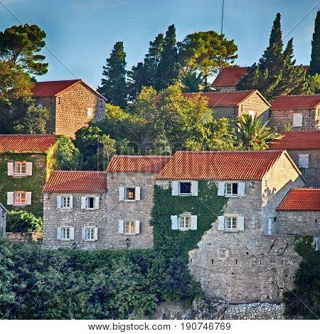 medieval houses on famous island-hotel Sveti Stefan, Montenegro, square image