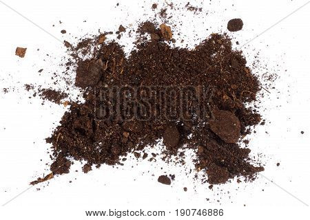 Soil, ground, brown land isolated on white background. Organic gardening, agriculture. Nature closeup. Environmental texture, pattern. Mud on field.