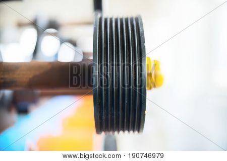 Auxiliary transfer rubberized rollers of an automatic winding machine. Equipment for winding wire on bobbins.