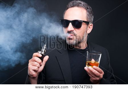 Male Smoking An Electronic Cigarette