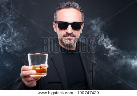 Exclusive Man Holding Glass Of Whiskey