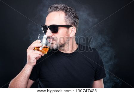 Confident Young Man With Glass Of Whiskey