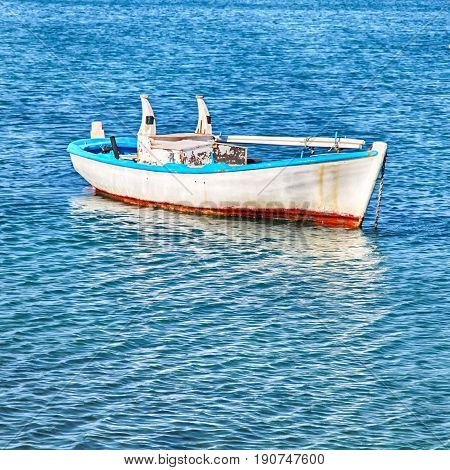 Blue and white old wood boat at a Mediterranean sea, Greece. Square image