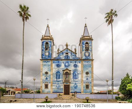 View at the azulejo tiles decoration facade church Santa Marinha in Cortegaca - Portugal