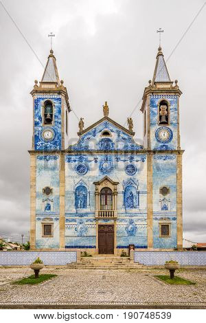 View at the azulejo decoration facade church Santa Marinha in Cortegaca - Portugal