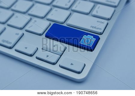 Camera flat icon on modern computer keyboard button Business internet camera service concept