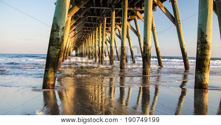 Myrtle Beach Pier. Under wooden pier on the coast of the Atlantic Ocean in Myrtle Beach, South Carolina.