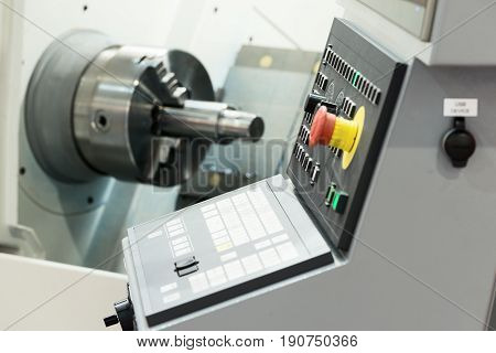 Control panel of modern lathe. Abstract industrial background.