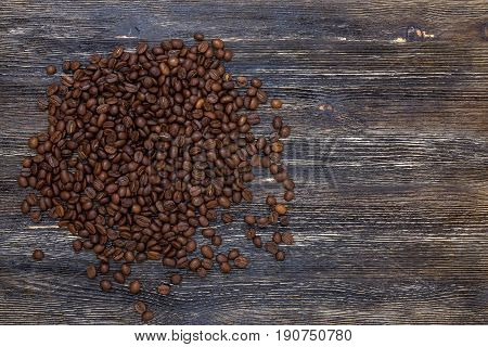 Beautiful fresh roasted coffee beans on wooden table