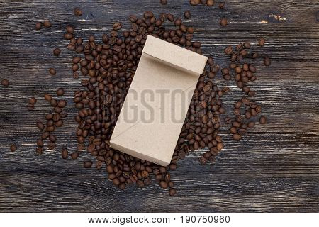 Beautiful coffee beans and on wooden table