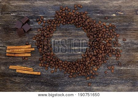 Beautiful coffee beans and cinnamon and on wooden table