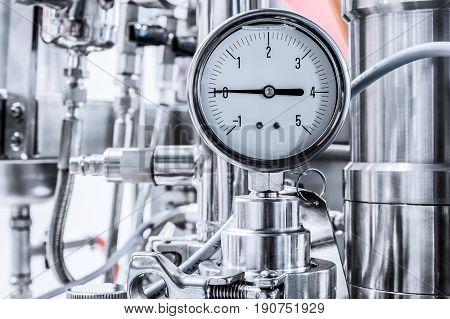 Hydraulic fluid pressure indicator, arrow indicates zero. Pharmaceutical equipment.