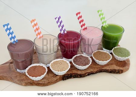 Healthy diet food supplement drinks with corresponding  powders of chocolate whey, maca root herb, acai berry,  pomegranate fruit and wheat grass. Also used by body builders.