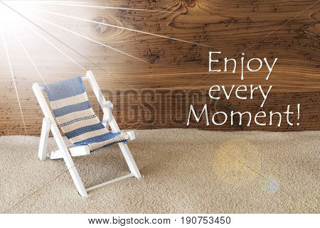 Sunny Summer Greeting Card With Sand And Aged Wooden Background. English Quote Enjoy Every Moment. Deck Chair For Holiday Or Vacation Feeling.