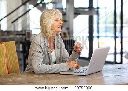 Happy Older Business Woman Working On Laptop