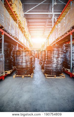 Warehouse industrial and logistics companies. Coiled plastic pipe. Toning the image. Bright sunlight.