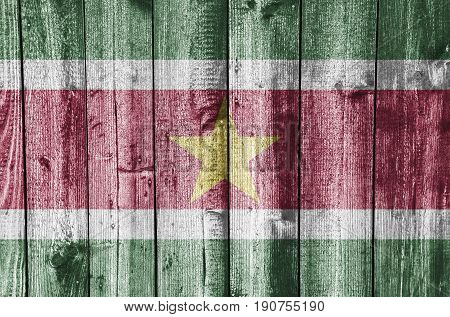Flag Of Suriname On Weathered Wood