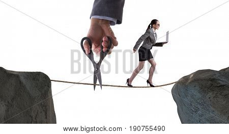 Hand cutting the rope under businesswoman tightrope walker